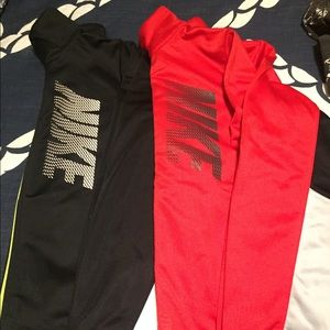 Two Nike zip up jackets